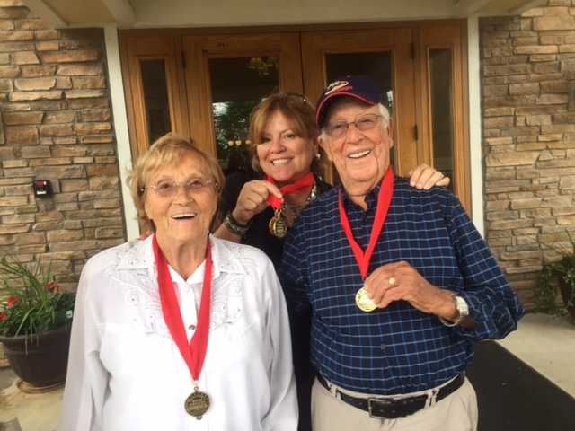 Joe and Irene Rubinstein, and author Nancy Sprowell Geise wearing the gold medals from FAPA book awards.
